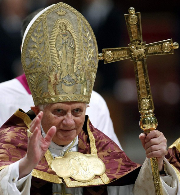 Pope Benedict XVI waves after celebrating the First Vespers in Saint Peter's Basilica at the Vatican