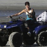 File photo of pop star Justin Bieber driving an all-terrain vehicle at a resort in Punta Chame on outskirts of Panama City