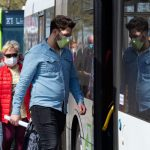 27 April 2020, Brandenburg, Potsdam: Passengers with face masks board a bus stopping at the main station. Since April 27, 2020, anyone who travels by bus or train or goes shopping in Brandenburg has had to wear a mouth and nose protection. Photo: Soeren Stache/dpa-Zentralbild/ZB